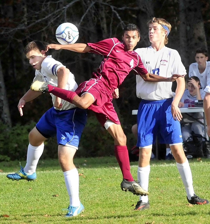 KICKING THE BALL: Messalonskee's Ryan Erskine, left, and Dylan Burton, right, defend against Bangor's Eli Clein during the Eagles 2-1 loss Tuesday in Oakland. Burton later scored a goal off an assist from Erskine for Messalonskee.