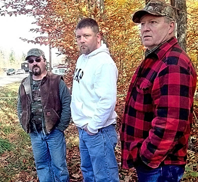 David Stevens, left, said it was unerving that there was a search for Ayla Reynold's body on Wednesday near his home in Oakland. He was with his brother Wil, center, and their uncle, Paul, near the area being searched.