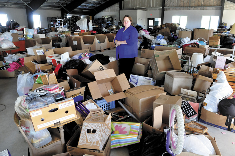 Mid-Maine Homeless Shelter Executive Director Betty Palmer stands in the second floor of the Waterville facility that is filled with items used by clients at the shelter. Plans are being considered to renovate the space for employment training and a daycare.