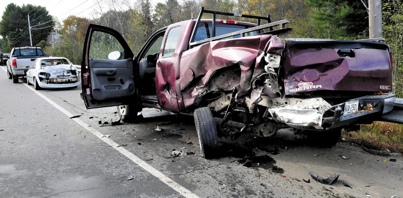 CHAIN REACTION: This Warden Service truck was rear-ended by a vehicle traveling south on Route 150 in Skowhegan causing the vehicle to overturn and the truck to smash into the vehicle ahead of it on Thursday, Oct. 10, 2013.