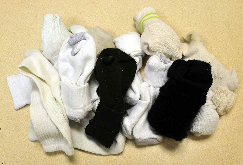 A pile of socks are available for students that need them at the George Michell School in Waterville.