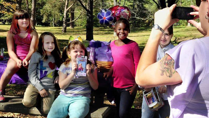 The beautiful summer-like day on Sunday brought these kids outdoors to celebrate the birthday of Cynthia Morin, 7, holding a present, as Anna Morin, at right, photographs the kids at Coburn Park in Skowhegan. From left are Hannah Huntley, Mikayla Chase, Cynthia, Beyonce Ward and Emma Huntley.