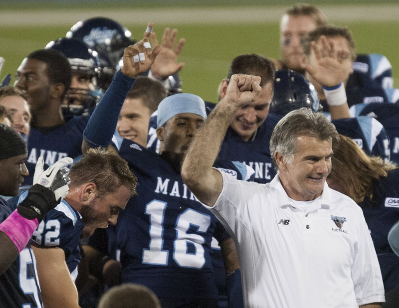 UMaine Coach Jack Cosgrove is all smiles after his Black Bears put on an offensive clinic that resulted in black and blue Blue Hens.