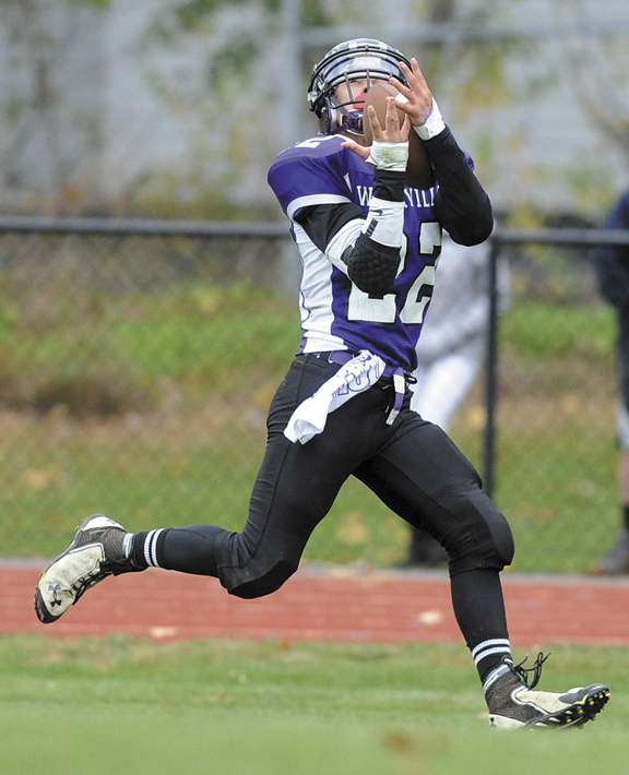 HAULING IN THE CATCH: Waterville Senior High School's Dalton Denis catches a touchdown pass against Winslow High School in the Battle of the Bridge on Saturday in Waterville. Waterville defeated Winslow 25-21.