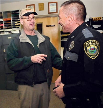 PROMOTED: Clinton police officer Rusty Bell, left, has been promoted to the rank of sergeant. Bell speaks with patrolman Karl Roy.