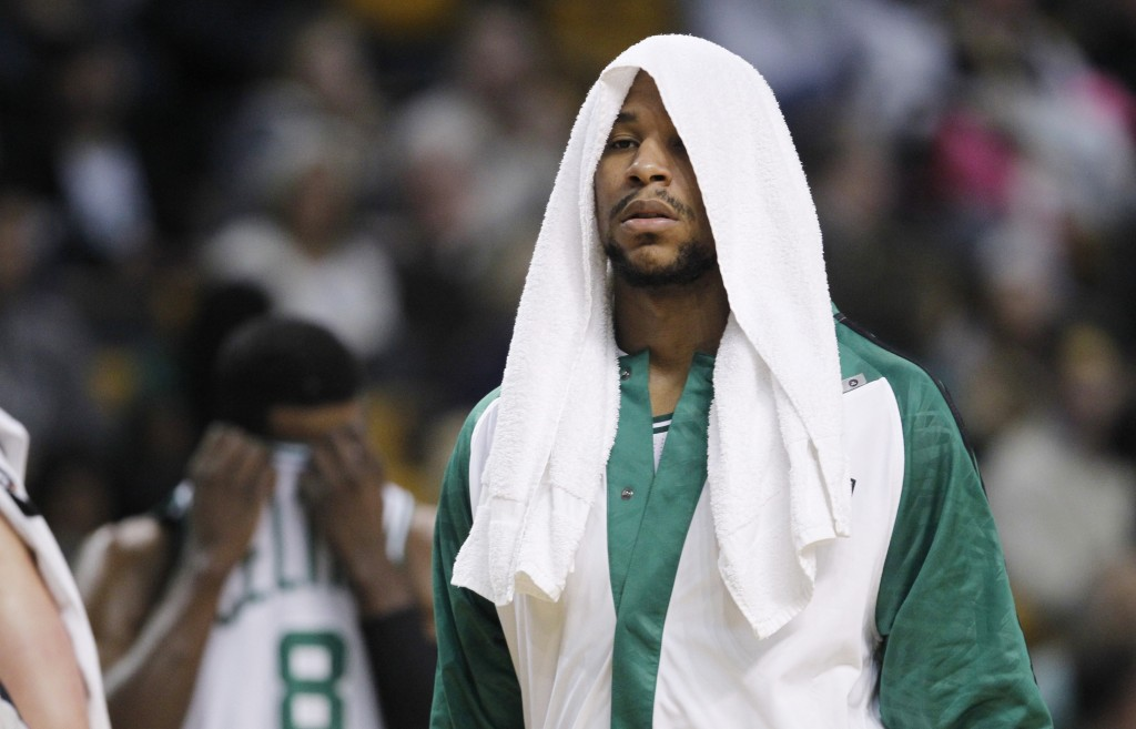 TOUGH NIGHT: Boston Celtics forward Jared Sullinger (7) wraps his head in a towel during the first quarter of an NBA basketball game against the Indiana Pacers, Friday, Nov. 22, 2013, in Boston. The Pacers defeated the Celtics 97-82. (AP Photo/Charles Krupa)