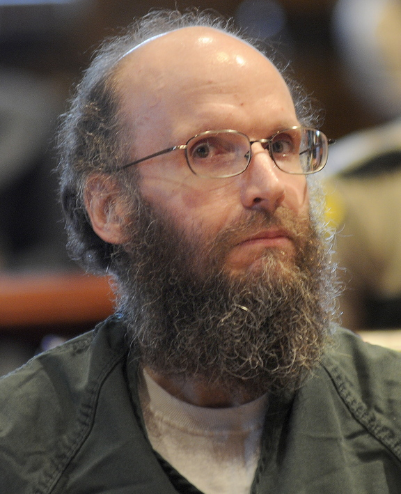 ADMISSION: Christopher Knight sits in the Kennebec County Superior Court on Monday in Augusta while entering guilty pleas for multiple burglaries and thefts while living in the woods of central Maine for 27 years. Knight agreed to plead guilty in exchange for receiving an alternative sentence with the Co-Occurring Disorders Court, a special, intensive supervision program where he will live and work in the community while reporting weekly to a judge.