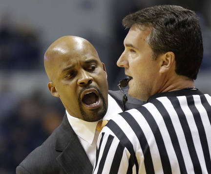 Tennessee coach Cuonzo Martin questions an official in the first half of an NCAA college basketball game against Xavier on Tuesday in Cincinnati. Referees are more tightly enforcing the rules this season.