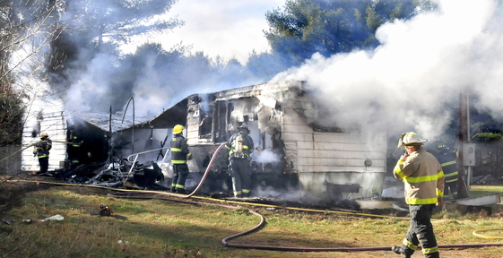 GONE: Madison firefighters put out the fire that destroyed a mobile home on Preble Avenue on Thursday,