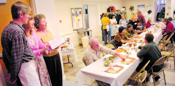 DINNER MUSIC: Jan Corcoran, left, Brin Amberlee, and Connie Hanson sing a hymn during a recent Thanksgiving dinner at the Green Street United Methodist Church in Augusta.