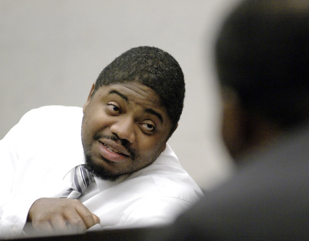In this Oct. 28, 2008 file photo, defendant Michael Addison talks with a member of the gallery during a break in the capital murder trial of Addison in the death of Manchester Bicycle Police Officer Michael Briggs, in Hillsborough County Superior Court in Manchester, N.H. Addison was sentenced to death in 2008 for Briggs' murder. On on Wednesday, Nov. 6, 2013, New Hampshireís Supreme Court will rule on the constitutionality of the stateís death penalty and whether the death sentence of Addison will stand.