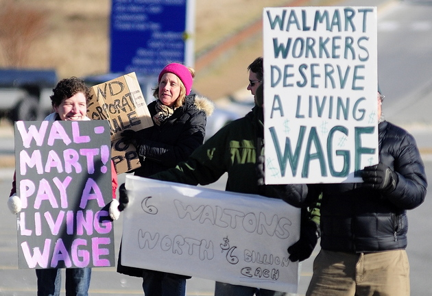 PROTESTERS: Protesters hold signs on Xavier Loop during a Black Friday protest at the Walmart Supercenter in Augusta.
