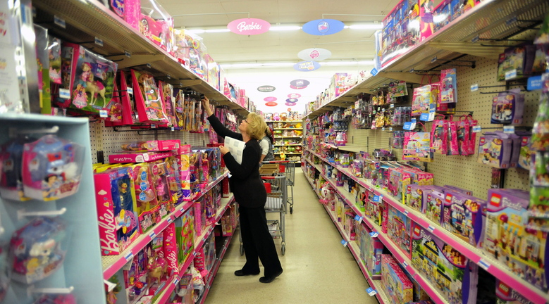 BLACK FRIDAY: Laurie Brown, assistant manager of the Waterville Kmart, marks prices down in the toy department during the Black Friday sales in Waterville on Friday morning.