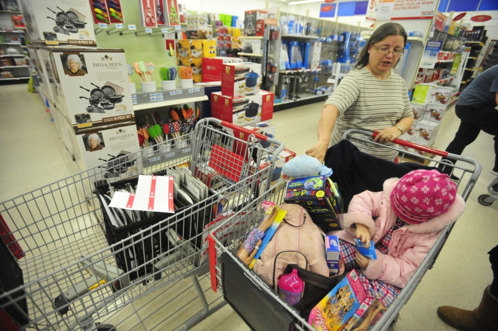 BLACK FRIDAY: Karla Schieferstein shops with her granddaughter Natalie Feris, 3, both of Fairfield, to take advantage of the Black Friday sales at Kmart in Waterville early Friday morning.