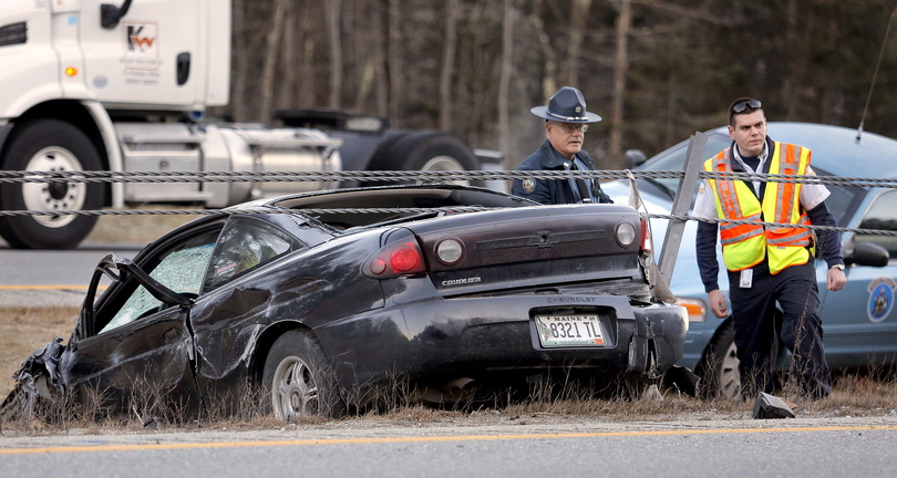 Emergency workers respond to a single-vehicle accident on Interstate 295 in Cumberland on Friday.