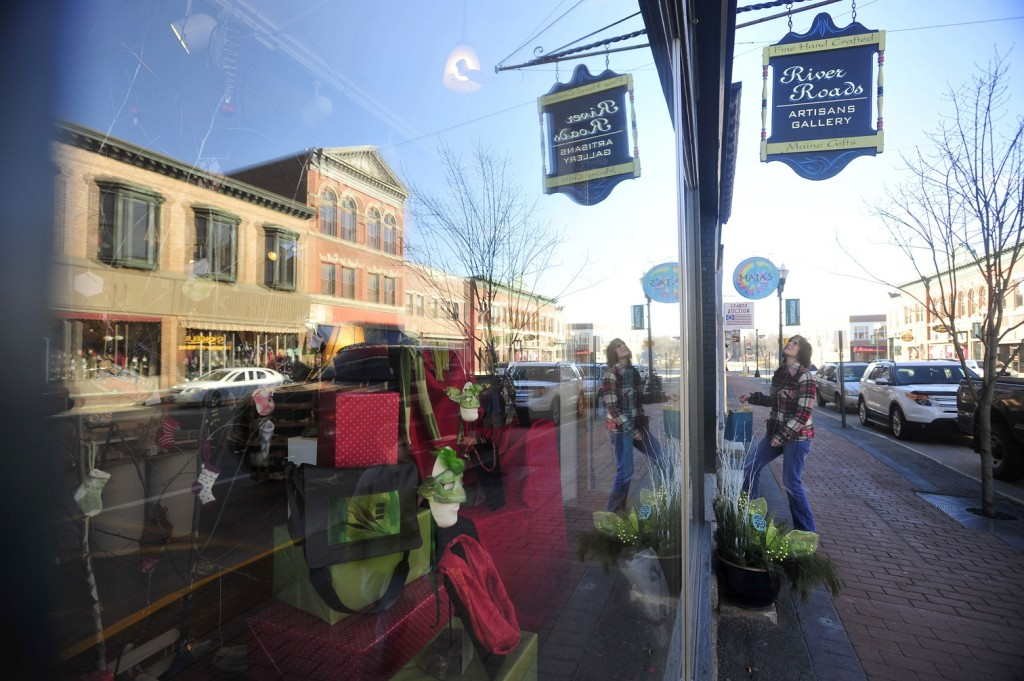 Local merchant: A shopper enters the River Roads Artisans Gallery on Saturday on Water Street in downtown Skowhegan. Saturday was Small Business Saturday, during which local stores offer special holiday deals.