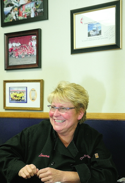 Legacy of Charity: Sitting beside several framed thank-you notes from organizations that benefited from Red Barn fundraisers, owner Laura Benedict talks to a reporter Saturday at The Red Barn in Augusta.