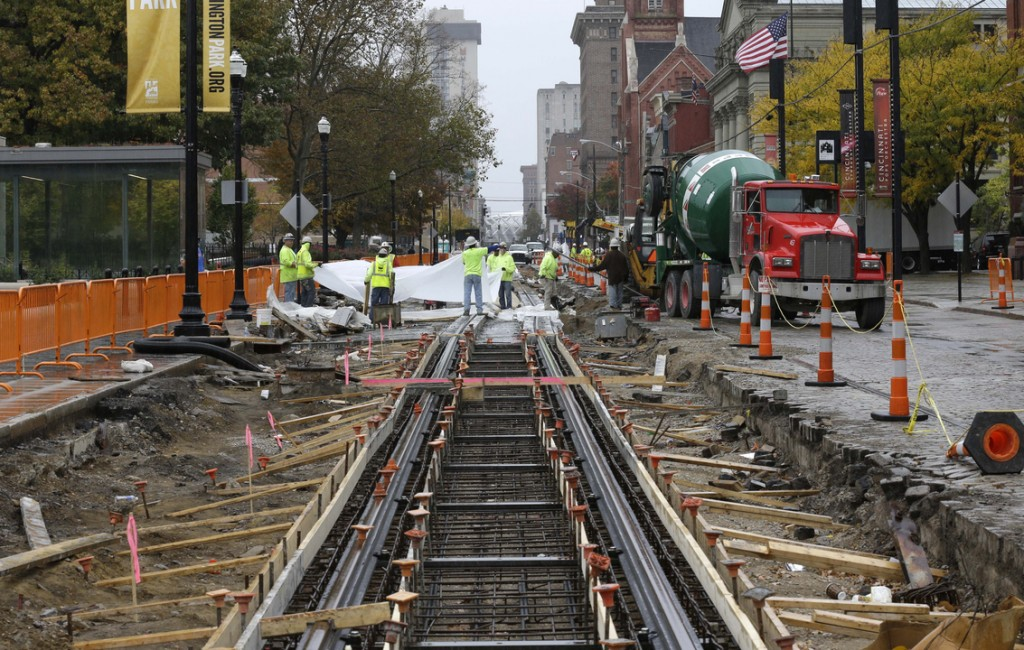 Work continues on a $133 million streetcar project recently in Cincinnati. More than $23 million has been spent demolishing buildings, moving utility lines underground, tearing up streets and laying the first part of the 3.6-mile track.