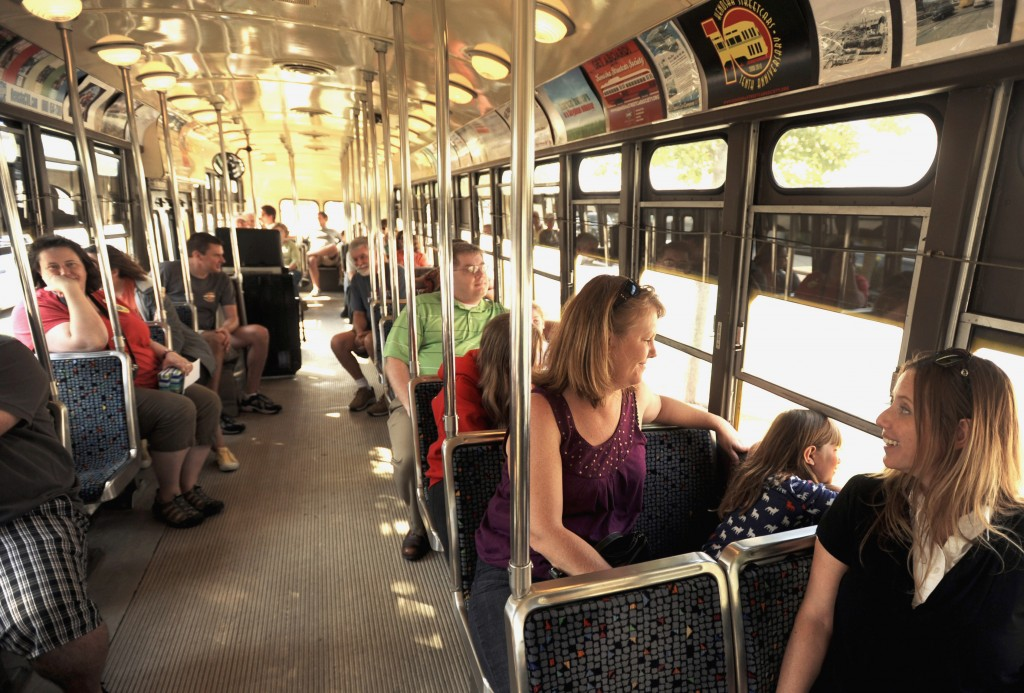Wendy Larsen, third from right, sits with her granddaughter Madison Larsen, 7, and Madison's aunt Dana Larsen, right, all of Kenosha, Wis., as thety enjoy a ride aboard the Cincinnati streetcar, one of several brightly colored antique trolleys that the city has re-introduced to its city streets to help reinvent the city and fill its depressed downtown with life.