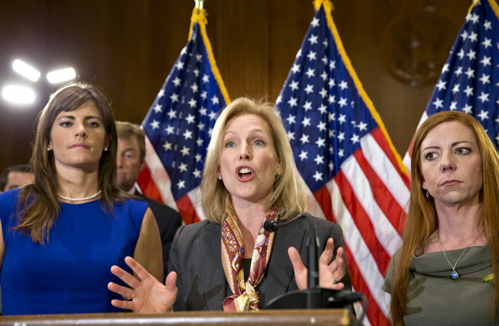 Sen. Kirsten Gillibrand, D-N.Y., center, flanked by victims of sexual abuse in the military, speaks at a news conference Tuesday about her proposed changes to how the military deals with alleged crimes.