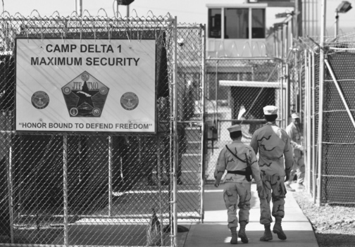 ENTERING GUANTANAMO BAY PRISON: U.S. military guards walk within Camp Delta military-run prison, at the Guantanamo Bay U.S. Naval Base, Cuba. Some detainees have been held since shortly after 9/11.