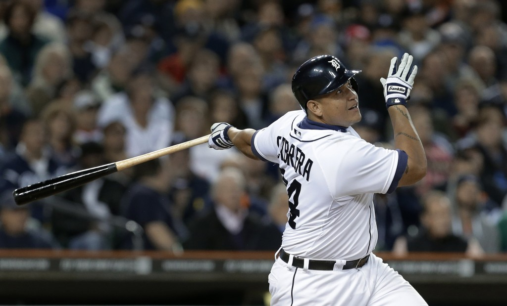 In this Sept. 16, 2013, photo, Detroit Tigers' Miguel Cabrera bats against the Seattle Mariners in a baseball game in Detroit. Cabrera has won the American League Most Valuable Player award for the second straight year. Cabrera won by a comfortable margin Thursday, Nov. 14, getting 23 of 30 first-place votes from members of the Baseball Writers' Association of America. (AP Photo/Paul Sancya)