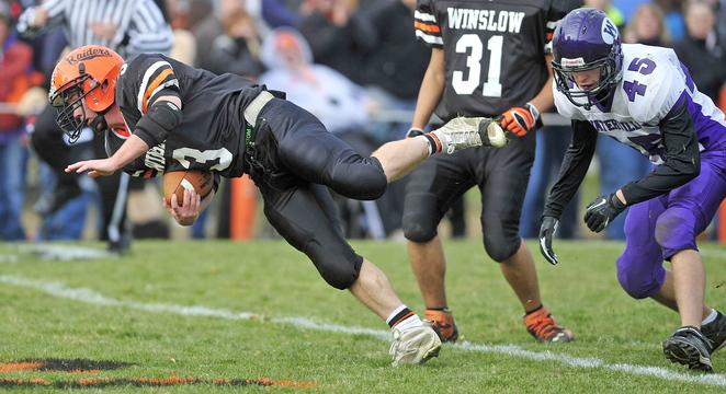 Staff photo by Michael G. Seamans Winslow High School's Dylan Hapworth, 3, dives for a touchdown in the first quarter against Waterville Senior High School in the Class C Eastern championship game in Winslow on Saturday. Winslow defeated Waterville 49-12.