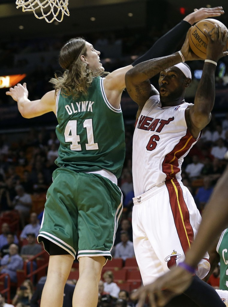 Miami Heat's LeBron James (6) shoots as Boston Celtics' Kelly Olynyk (41) defends during the first half of an NBA basketball game Saturday, Nov. 9, 2013, in Miami.