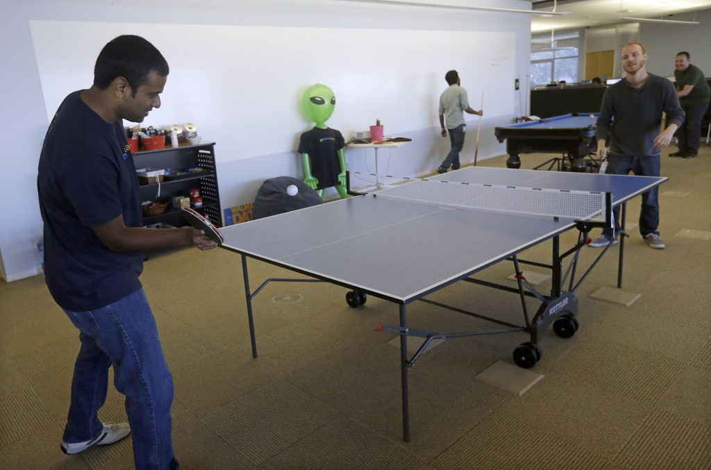 Pranay Kuruvilla, left, senior software engineer for Walmartlabs, plays ping pong with Benjamin Pellow, principal software engineer, at the Walmart.com office in San Bruno, Calif. Wal-Mart has embraced a Silicon Valley startup feel with its San Bruno offices – in stark contrast to the company's rambling brick headquarters with its frayed carpets and '70s-style paneling.