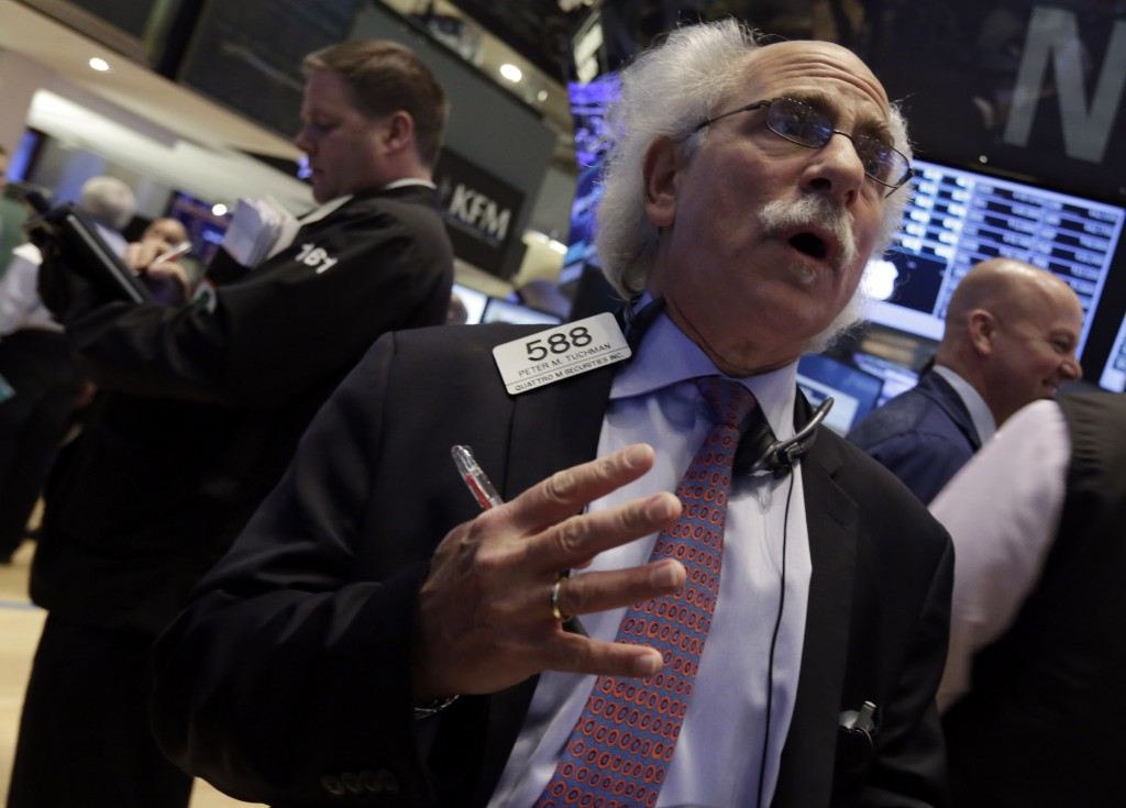 Trader Peter Tuchman works on the floor of the New York Stock Exchange on Wednesday. Stocks rose in early trading Wednesday, sending major indexes back to record highs, as traders anticipated that the Federal Reserve will keep up its stimulus program for some time.