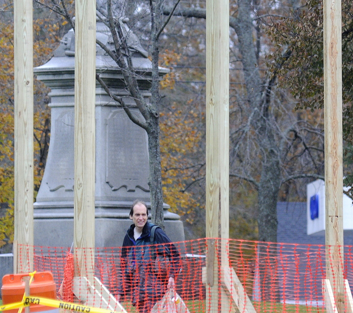 GOING UP: Steve Jordan inspects the beams Thursday of the new gazebo that's being erected at the Gardiner Common.