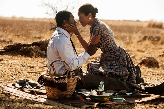 "This image released by The Weinstein Company shows Idris Elba, as Nelson Mandela, left, and Naomie Harris as Winnie Mandela in a scene from ""Mandela: Long Walk to Freedom."" The film will get an audience from President Barack Obama, as well as a screening at the Kennedy Center hosted by Hilary Clinton."