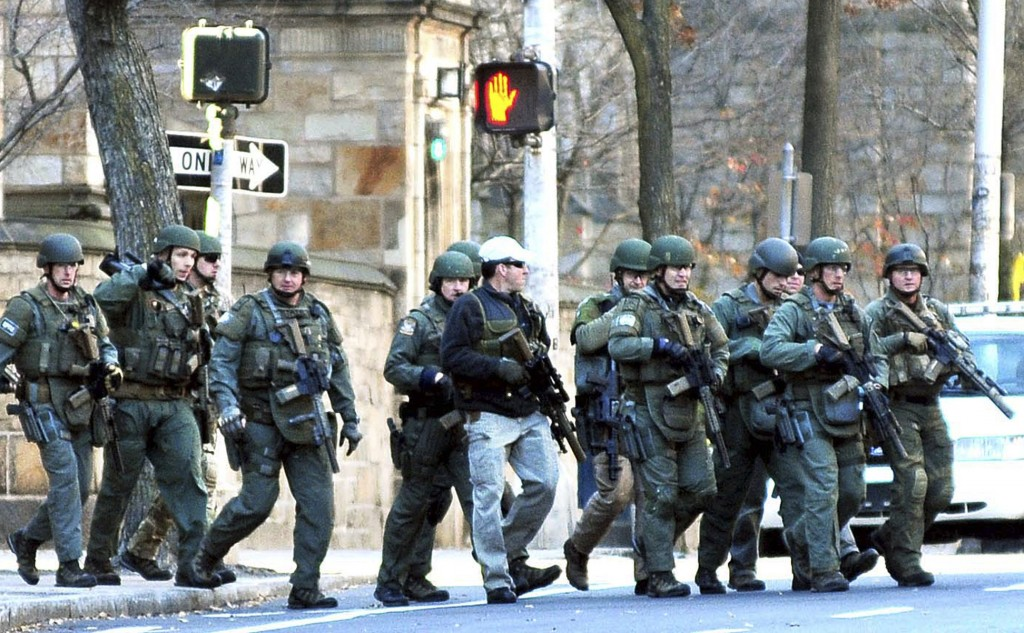 Police respond to the reports of a gunman on Yale campus Monday, Nov. 25, 2013, in New Haven, Conn. A lockdown remained in effect on the Old Campus Monday afternoon as police search rooms to confirm that no gunman is on campus.