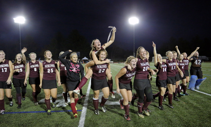 WE WON: Nokomis celebrates its 1-0 victory over York in the Class B field hockey state championship Saturday at Yarmouth High School.