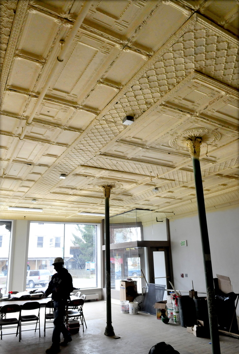 HISTORIC: Contractor Randy Woodworth works inside a room where original tin ceiling panels were restored and replaced inside the Gerald Hotel in Fairfield.