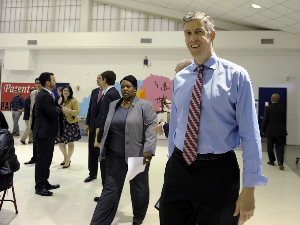 Education Secretary Arne Duncan arrives for a visit to Malcolm X Elementary School in Washington on Thursday.