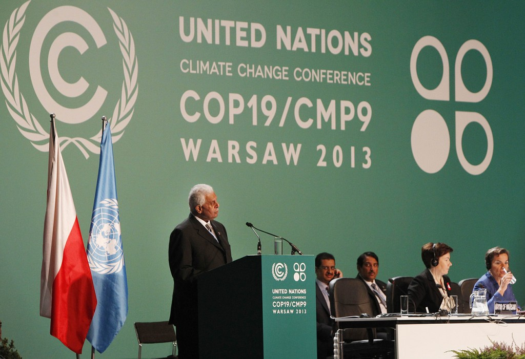 Qatar's Abdullah Bin Hamad Al-Attiyah,left, addresses delegates during the opening session of the United Nations Climate Change Conference COP19 in Warsaw, Poland, Monday, Nov. 11, 2013. Thousands of participants from nations and environment organizations from around the world have opened two weeks of U.N. climate talks that are to lay the groundwork for a new pact to prevent global warming. (AP Photo/Czarek Sokolowski)