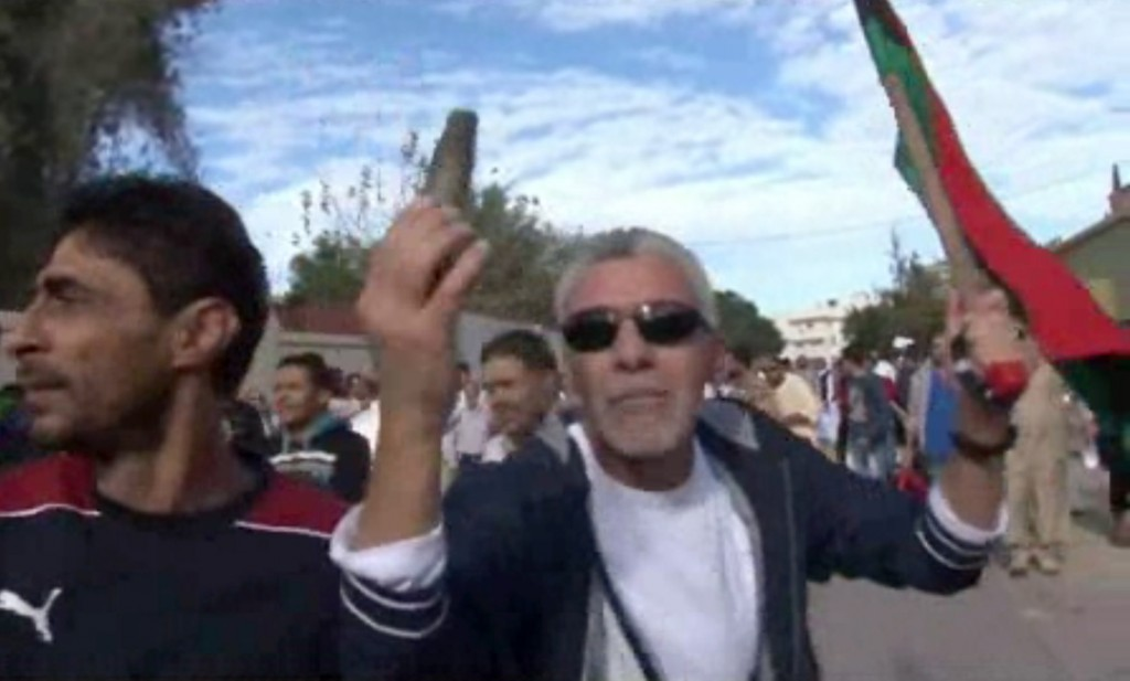 This image made from video shows a protester holding up spent ammunition in Tripoli, Libya, after militiamen attacked peaceful protesters demanding the disbanding of the country's rampant armed groups on Friday.