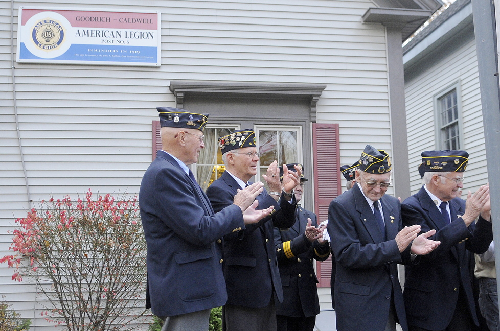 Celebration: Members of Hallowell's American-Legion Post applaud members of Boy and Girl Scout packs that helped prepare a free breakfast for veterans Monday morning at the Post. The veterans and scouts went to the Hallowell Cemetery following the breakfast for a Veterans Day ceremony.