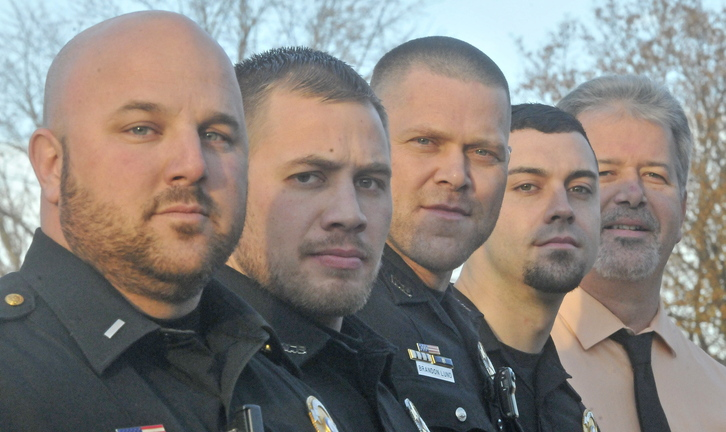 "NO SHAVE NOVEMBER: Winslow Police Department's from left to right, Lt. Josh Veilleux, Ron McGowen, Brandon Lund, Haley Fleming and Chief Jeffrey Fenlason, show off their stubble as they participate in ""no shave November"" to raise money for the Barbara Bush Childrens Home."
