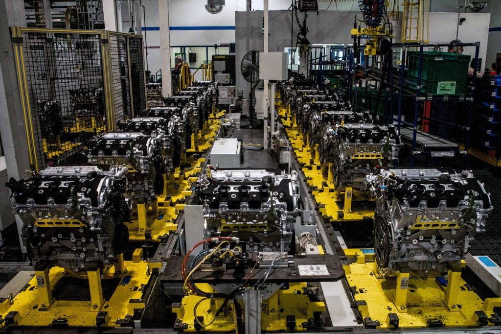 This photo shows the production line of the General Motors 3.6-liter, 302 horsepower (224 kW) V6 engine at GM's Flint Engine on Wednesday, Nov. 20, 2013, in Flint, Mich.