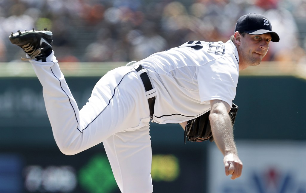 FILE - In this Aug. 29, 2013, file photo, Detroit Tigers' Max Scherzer watches a pitch to an Oakland Athletics batter in the first inning of a baseball game in Detroit. Scherzer won the American League Cy Young Award on Wednesday, Nov. 13, 2013. (AP Photo/Paul Sancya, File)