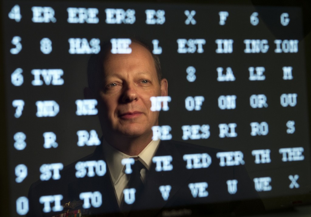 Rear Admiral William E. Leigher, reflected in a computer screen, is a Maine native who is one of the Navy's top cybersecurity officials.