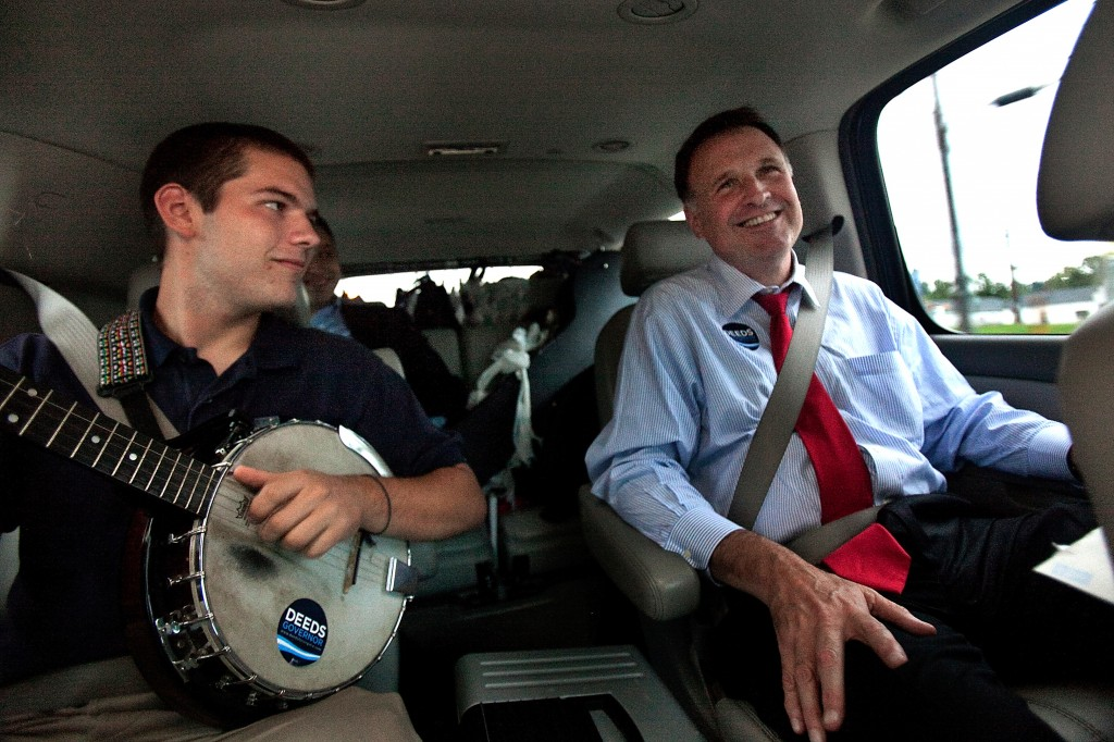 In a Sept. 25, 2009 photo, Democratic gubernatorial candidate Creigh Deeds spends time with his son Gus, left, on the road to Halifax, Va., between campaign events. Virginia State Police confirmed Tuesday, Nov. 19, 2013 that Creigh Deeds was stabbed multiple times and his son Gus, 24, was shot and killed at Deeds' Home in Bath County, Va., during a Tuesday morning assault.