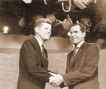 BEFORE THE DEBATE: John Kennedy, left, and Richard Nixon shake hands before their first televised debate.