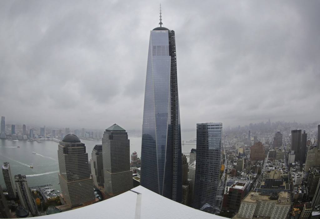 One World Trade Center is seen from the 56th floor of its neighbor, 4 World Trade Center, recently in New York. The 1,776-foot One World Trade Center is the marquee skyscraper at ground zero; but the first office tower to open there will be its shorter neighbor 4 World Trade Center on Wednesday.