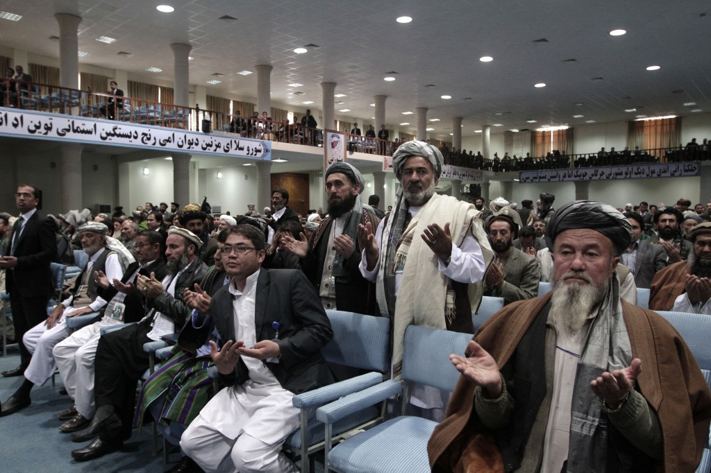 Members of the Afghan national consultative council known as the Loya Jirga pray Sunday during the last day of the assembly in Kabul, Afghanistan.