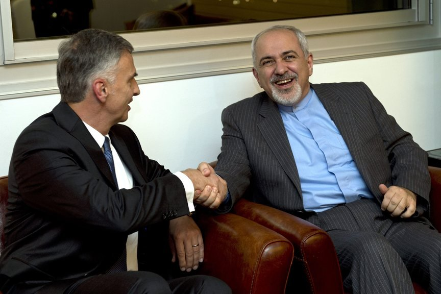 Switzerland's Foreign Minister Didier Burkhalter, left, shakes hands with Iranian Foreign Minister Mohammad-Javad Zarif, during a meeting at the Intercontinental Hotel prior to talks about Iran's nuclear program in Geneva, Switzerland, Saturday.