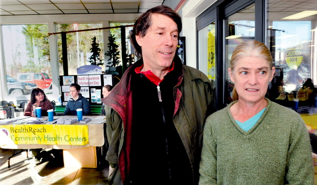 INTERESTED: Peter Richmond and Phyllis Leonard speak about their interest in Affordable Health Care after getting information from HealthReach workers, in background, who had a table set up at Jimmy's Market in Bingham on Thursday.