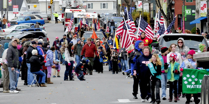 TRIBUTE: Participants in the Veterans Day parade make their way down Main Street in Waterville on Monday, Nov.11, 2013.
